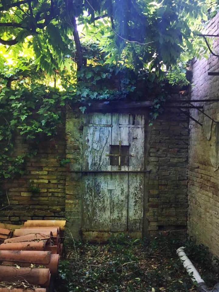Porta segreta giardino Bologna